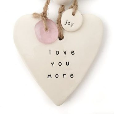 Handmade ceramic heart wall hanging 'love you more'